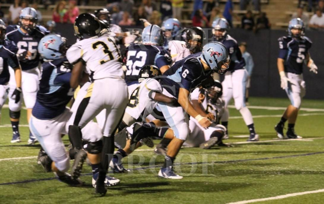 Chapin's Logan Bailey rushes for a touchdown in the LR game.