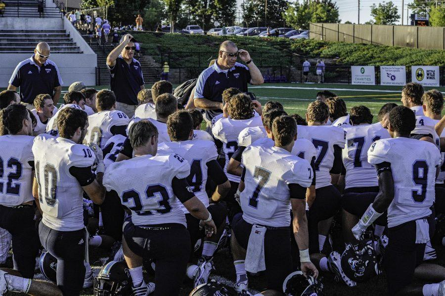 The coaching staff addressing the team after the victory (Picture courtesy of goflashwin).