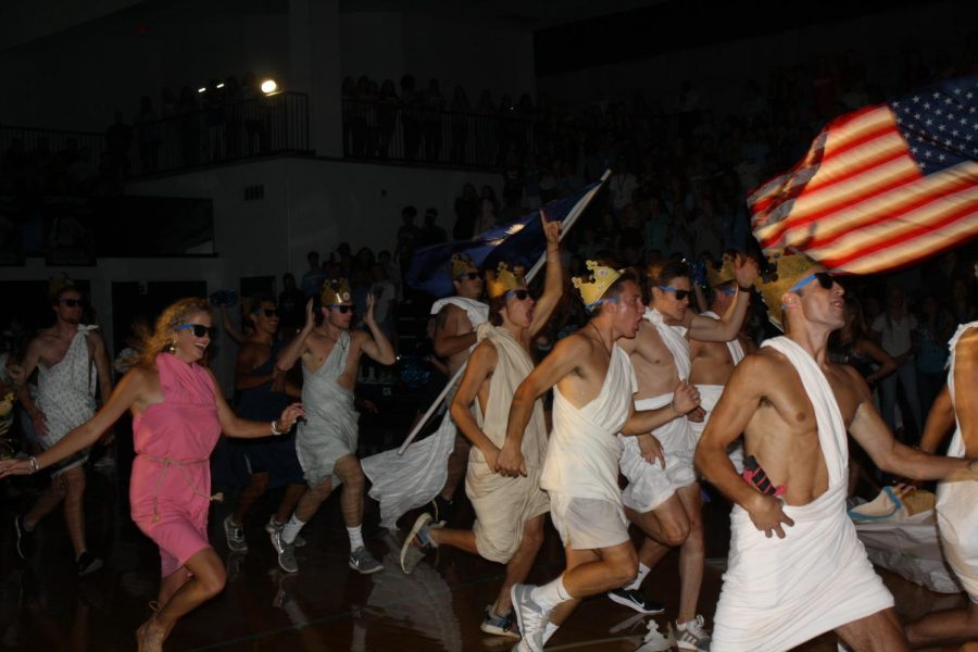 Seniors show confident strides as they make their grand entrance for the Pep Rally