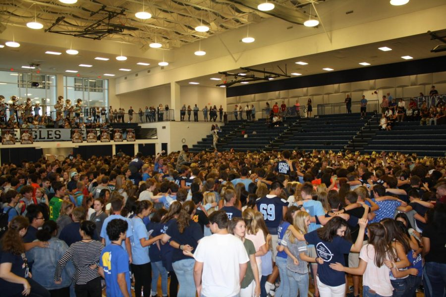 The pep rally ends, with a gathering of the students on the floor to sing the Chapin Alma Mater.