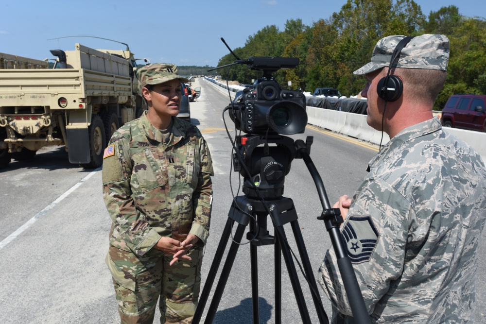 U.S. Army Capt. Jerusha Spain, commander of the 1051st Transportation Co, 218th Brigade Support Battalion, is interviewed by U.S. Air Force Master Sgt. Carl Clegg, a broadcaster from the South Carolina Air National Guard's 169th Fighter Wing,  Photo by Senior Master Sgt. Edward Snyder U.S. National Guard photo by Senior Master Sgt. Edward Snyder, 169th Fighter Wing, Public Affairs)