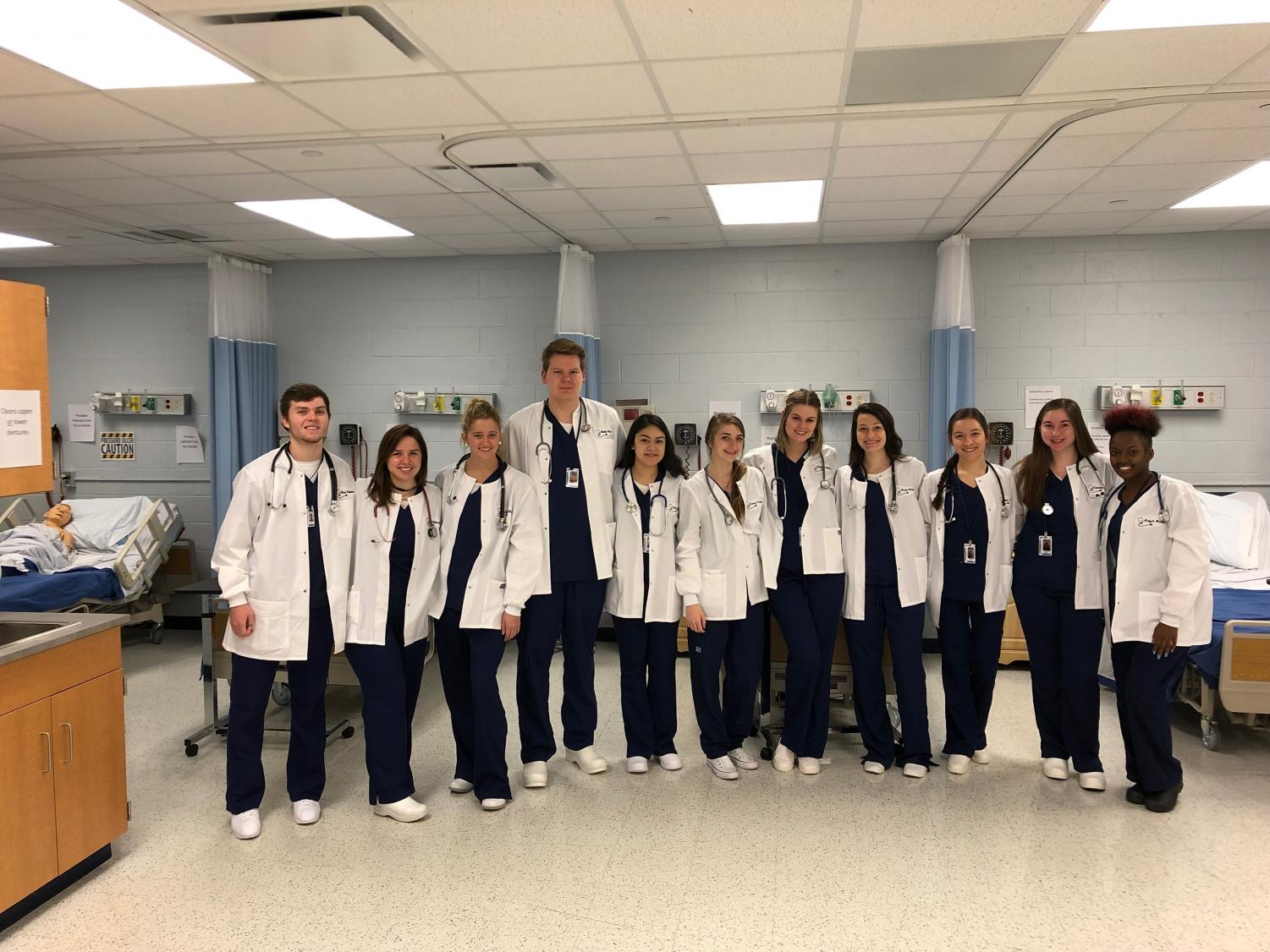 Health+Science+3+and+4+pose+in+their+new+lab+coats.