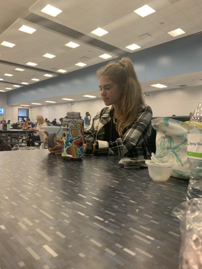 Junior Kate Stebbins seen during lunch sitting  a safe distance from other students.